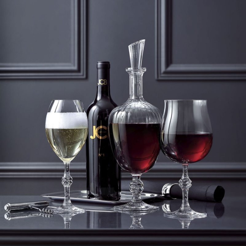 JCB PASSION collection. The glass, the one, the only, the ultimate. Dreamed and designed by JEAN-CHARLES BOISSET, created by Baccarat. In a box of 2 wine glasses for a true sensory experience. Inspired by wine, and in love with luxury, bold visionary and daring vintner JEAN-CHARLES BOISSET declares his admiration for Baccarat with the PASSION collection. Born into the world of wine in Burgundy, JEAN-CHARLES's lifelong passion began as a child, growing up among the vineyards. Today the vintner boasts a Franco-American collection of historical and unique wineries in the most prestigious terroirs, from Burgundy to California.
